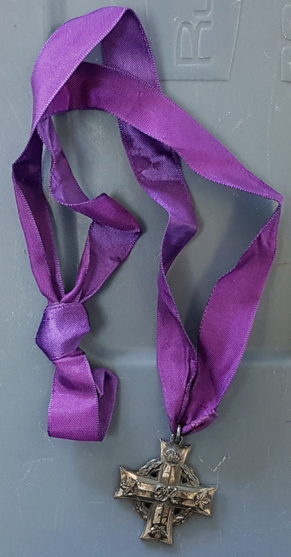 Medal with purple ribbon