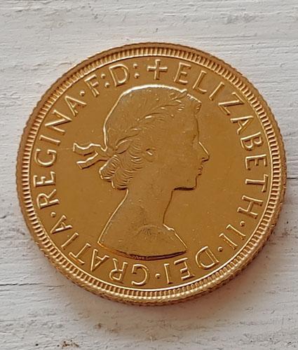 G.B. 1958 QEII Gold Sovereign lt scratch .234oz AGW